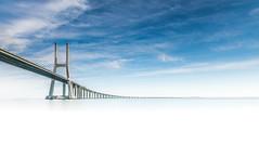 Vasco de Gama Bridge (JimiaS) Tags: quiet peaceful lisbon lisboa portugal tajo vasco de gama bridge wow dream dreams art creative view baeuty blue bleu paysage landscape nuage cloud pont