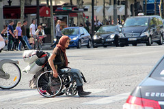 Homeless Gypsy Woman crossing Champs-Élysées (Jonno Cass) Tags: paris france lady bag one mercedes benz wheelchair homeless leg champs gypsy 2012 amputee merc