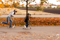 Drag Race (Prozac74) Tags: autumn fall race fun helmet scooter panning kickboard mywife allee fullsize dragrace eichenau canonef85mmf12liiusm prozac05 canoneos5dmarkii roggeinsteiner