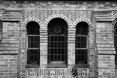 Triple window (Jon-UK) Tags: windows bw white black brick church details adoremus adorer adorar  adhradh addoliad