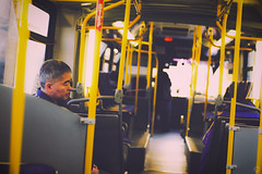 Too Early in the Morning (Alex Akopyan) Tags: old sun man bus vancouver zeiss sunrise asian early warm alone bright bokeh sleepy romantic lonely planar 5014 k7 petnax