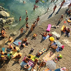 Italian families come to relax, swim and play (Bn) Tags: family blue sea summer vacation italy baby holiday hot beach water colors sunshine swimming children fun coast la seaside italian sand topf50 rocks mediterranean italia day mare afternoon locals play liguria families joy group relaxing traditions down tourist tourists line resort busy delight parasol grandparents towels cinqueterre bathing activity lying popular quaint monterosso topf100 sunbathing pleasure adriatic sunbather crowded cooling sunbeds overrun 100faves 50faves