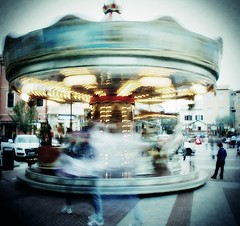 carousel (TIBBA69) Tags: street longexposure people italy canon eos strada italia colours child carousel persone explore ghosts colori giostra bambino cattolica 500d fantasmi lungaesposizione andreatiberini