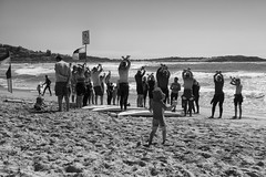 Waving not Drowning (Julie Byrnes) Tags: blackandwhite beach blackwhite noiretblanc candid streetphotography australia deewhy streetimages beachproject juliebyrnes