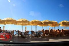 Travelling through Menton, France (catseye1812) Tags: france umbrella windshield windscreen menton beachumbrella