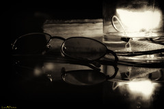 oil lamp and glasses (loco's photos) Tags: old blackandwhite reflection lamp monochrome sepia vintage dark glasses book candle pentax antique flame candlelight oliveoil eyeglasses oldfashioned highiso oillamp k30 da5514 silverefex2