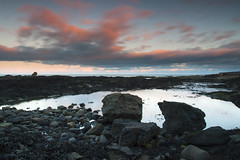 Pretty in Pink (Christian Hacker) Tags: pink light sunset sea seascape seaweed water pool rock clouds canon outdoors eos evening coast scotland rocks long exposure day cloudy fife path horizon north rocky scottish pebbles line boulders coastal kelp standrews barren formations 50d