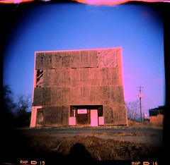 Ghost town cinema (anmyk) Tags: cinema building abandoned 120 film bar rural ga mediumformat georgia holga lomo xpro lomography crossprocessed closed theater fuji theatre decay crossprocess toycamera eerie creepy lightleak lightleaks squareformat ghosttown fujifilm boardedup 100 expired fujichrome derelict vignette abandonment ruraldecay ramshackle plywood dilapidated movietheater plasticcamera colorshift 120n deepsouth astia meigs plasticlens bargrill colourshift railroadtown thomascounty shuddered mitchellcounty formerbusiness boardedover anomyk