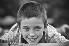 To be young (Proleshi) Tags: boy blackandwhite cute blancoynegro smile face vintage happy nikon child happiness freckles muchacho throughtheeyesofachild ifeelbetternow d300s proleshi jamaljosephs