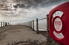 To Save A Life (Explore) (simon.anderson) Tags: landscape sussex fisherman alone jetty pebbles explore hastings seafront railings seascap explored simonanderson tosavealife nikon1685 nikond300s leehardndgrad09 5000poundfineandorimprisonment