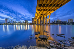 Blue Bridge [Explored] (Scintt) Tags: city travel bridge blue sunset sky urban panorama costa reflection tourism water gardens by skyline night clouds marina landscape lights evening bay hall still flyer scenery rocks long exposure flickr cityscape colours slow place stitch stones dramatic surreal images calm structure explore hour shutter getty benjamin sands exploration foreground raffles bahru kallang tanjong featured rhu sheares singaore scintillation explored scintt gettysingapore