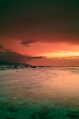 Sunset over Indian ocean (tsiklonaut) Tags: ocean travel sunset sea seascape motion beach port indonesia boats island boat asia indian sigma experience southeast float gili  motionless indonesian timeless discover foveon x3 trawangan    dp2     ilslands        dp2s tsiklonaut