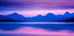 Twilight at Lake McDonald (jeanineleech) Tags: glaciernationalpark lakemcdonald montana sunrise mountains summer sunset usa twlight apgarvillage twilight morning purple pink mountain