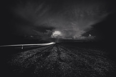 Fast like the Rain (Maximecreative) Tags: select rain cloud cloudscape road perspective lighttrail wideangle longexposure path cloudy dark monochrome blackandwhite bw countryside speed field noiretblanc sky lowlight switzerland samyang 14mm f28