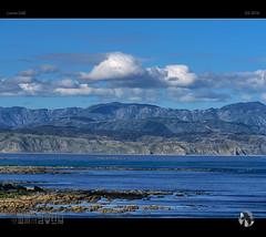 Hills of Pencarrow (tomraven) Tags: clouds sky mountains coast coastal pencarrow newzealand tomraven sea rocks lighthouse aravenimage q32016 lumix gx8