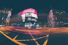 Piccadilly Circus , London (aquanandy) Tags: nikond7000 walimex fisheye lights lightstreaks lighttrails london londonist timeout timeoutlondon visitlondon visitbritain colours wrapspeed lines cocacola followers followifyoulike cityscapes tripping explore traveller wanderer wanderlust blackandyellow