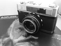 Minolta A5 (jcbkk1956) Tags: photography magazine blackandwhite mono 45mmf28 rokkor iphone5 film analog camera rangefinder a5 minolta monochrome