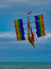Too Many Sails (Steve Taylor (Photography)) Tags: ship boat kite flying sail flag bunting art design colourful rainbow water newzealand nz southisland canterbury christchurch newbrighton ocean pacific sea summer sky cloud