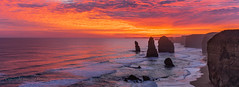 Fire in the sky (Howard Ferrier) Tags: oceania victoria sunset portcampbellnp stack dusk panorama southernocean orange clouds sea water waves southwest tangerine ocean island sky crimson twelveapostles coast cliff australia time elements landmass photography
