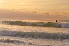 Over the waves (rafasalcines) Tags: surf surfing liencres sunset