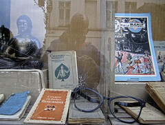 self portrait in brussels (maximorgana) Tags: old brussels reflection building feet broken window glass sign shop glasses book globe hands ancient cross traffic belgium antique wand magic suit reflected lap budha buda magician trebol