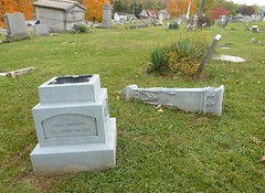 These monuments will endure for ages (Scott Beveridge) Tags: cemetery pennsylvania graves vandalism tombstones zinc fayettecounty gravemarker whitebronze