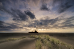 West Coast Fusion (Nick Twyford) Tags: sunset newzealand sky seascape colour beach clouds blacksand nikon wideangle auckland northisland westcoast karekare leefilters 1024mm d7000 lee06gndhard panatahiisland lee12gndsoft