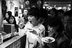 Scene from a party. (Dave from Tokyo) Tags: party people blackandwhite bw food blancoynegro monochrome japan tokyo blackwhite pessoas gente noiretblanc bn menschen personas persone   japo  japon personnes giappone biancoenero tokio  japn  blancetnoir   minamiaoyama  negroyblanco      blackwhitephotos  davidefilippini