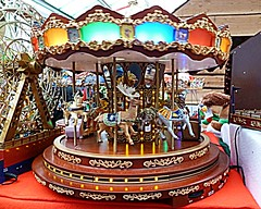 Fairground ride (BowBelle51) Tags: santa decorations train reindeer lights penguins fireplace fairground donkey carousel robins polarbear nativity snowglobe eskimo baubles meerkats fircones