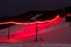 Torch Light Parade on Ski Lift (Free Roaming Photography) Tags: winter light usa mountain snow mountains west jackson celebration event skiresort skilift northamerica wyoming festivity festivities torchlightparade flares jacksonhole torchlight snowking ipsssdr internationalpedigreestagestopsleddograce snowkingskiresort