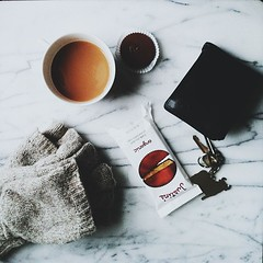 Tea, chocolate, emptied pockets. It's been a long day. (TheSophisticatedGourmet) Tags: square keys tea wallet chocolate gloves squareformat iphoneography instagramapp uploaded:by=instagram