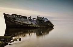 Forgotten Dignity (Lindi m) Tags: old longexposure seascape abandoned broken reflections boats plymouth shining wrecks thegalaxy hooelake bestofshining shiningexcellence besteverexcellencegallery