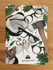 Herr Menig Optik in the Woods (Philipp Zurmoehle) Tags: wood shop illustration glasses saw oak drawing postcard ad drawings pins scissors acorn commercial postcards axe herr optician optik menig herrmenig