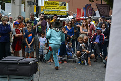 He's Got Their Attention (swong95765) Tags: cowboy lasso crowd entertainment tips smiles wow street show