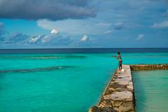 Fisherman in the harbor (ReinierVanOorsouw) Tags: maldives maldivian malediven thoddoo travelphotography sony reiniervanoorsouw  indianocean a7rii   maldiverne travelling island islandlife ocean  maldivas  sonya7rii sonya7r travelstoke maldive  reizen reiniernothere  maldivler  people human mensen turquoisewater turquoise fishing fisherman harbour haven vissen