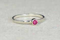 Classic CZ Ruby / Na (alaridesign) Tags: classic cz ruby natural sterling silver ring these rings simple but substantial heirloom quality bands bezels hammered rustic understate handmade alari alaridesign birthstonering jewelry julybirthstone mothersring naturalruby silversolitaire silverband silverring silverrubyring solitairering solitairerings stackingrings sterlingsilver