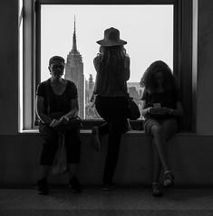 Empire State (John St John Photography) Tags: topoftherock 30rockefellercenter newyorkcity newyork empirestatebuilding women people peopleofnewyork peopleoftheworld window windowsill blackandwhite blackwhite bw monotone