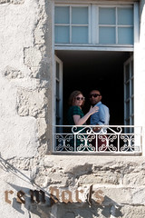Lovers at the window (m-blacks) Tags: carcassonne france aude travel vacation summer holiday august carcassona francia medieval roof street streetphotography window detail people lovers facade