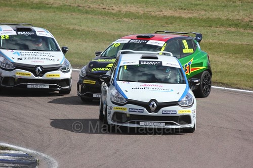 Mike Bushell leads Ant Whorton-Eales and Paul Rivett at Rockingham during the Clio Cup, August 2016