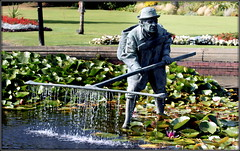 Old shrimper statue (* RICHARD M (Over 5 million views)) Tags: lowthergardens lythamstannes lytham stannesonsea shrimper statues lilypond water fyldecoast lancashire waterlillies nymphaeaceae aquaticplants flowers flora plants botany fountain fountains