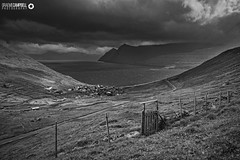 Funningur (gcfotographos) Tags: ngc nikon mood moody clouds d600 europe faroe faroeislands mono bnw sea water mountains fence gate landscape grass funningur village remote valley hill hills