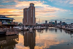 Light the Sky (Isaac Guerrero) Tags: water cityscape skyline city boats color sunset innerharbor baltimore harborview