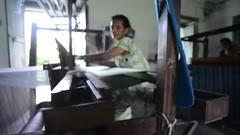 Rhythm (www.WeAreHum.org) Tags: textile nepal thread bobbins gandhi tulsi ashram school for women kathmandu sowing weaving winds threads mechanical loom wood shuttles feet arts