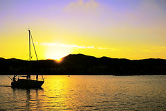 One more before you leave us (Fnikos) Tags: sea seascape landscape water boat coast shore people sunset evening waterfront sky skyline light serene vehicle outdoor