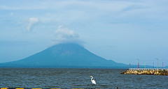 Concepcion volcano (E. Aguedo) Tags: volcano concepcion lake heron water clouds pier nicaragua central america bird mountain ngc