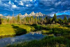 The Grand Teton Range Wyoming (jetguy1) Tags: thegrandtetons wyoming grandtetonnationalpark mountains reflection clouds travel nationalpark nps sky weather explore