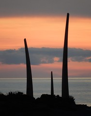Silhouetted Tusks (mikecogh) Tags: glenelg sunset horizon tusks publicart sculpture silhouette