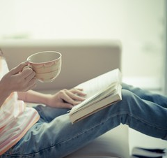 Reader (jancamilleri) Tags: woman female sitting home indoors enjoy book leisure lifestyle casual person reading literature studying education hobby knowledge student tea coffee focus mug novel holding unrecognizable hot beverage drink rest relax teacup domestic life tasty alone sideview jeans cropped sofa story comfortable cozy young couch peaceful interested concentrated beautiful fresh