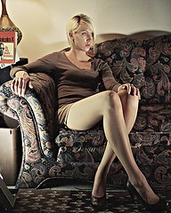 Portrait of Molly on a Couch 1 (neohypofilms) Tags: portrait sexy slr art classic film girl beautiful beauty 35mm vintage hair studio photography eyes nikon long pretty noir pumps toe shadows legs style retro couch photograph blonde 70s heels series peep tall concept grainy 1970s conceptual drama fm2 peeptoe neohypofilms cinehypofilms