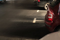 Car Park Darkness (pongyc) Tags: light car wheel vehicle carpark tyre numberplate